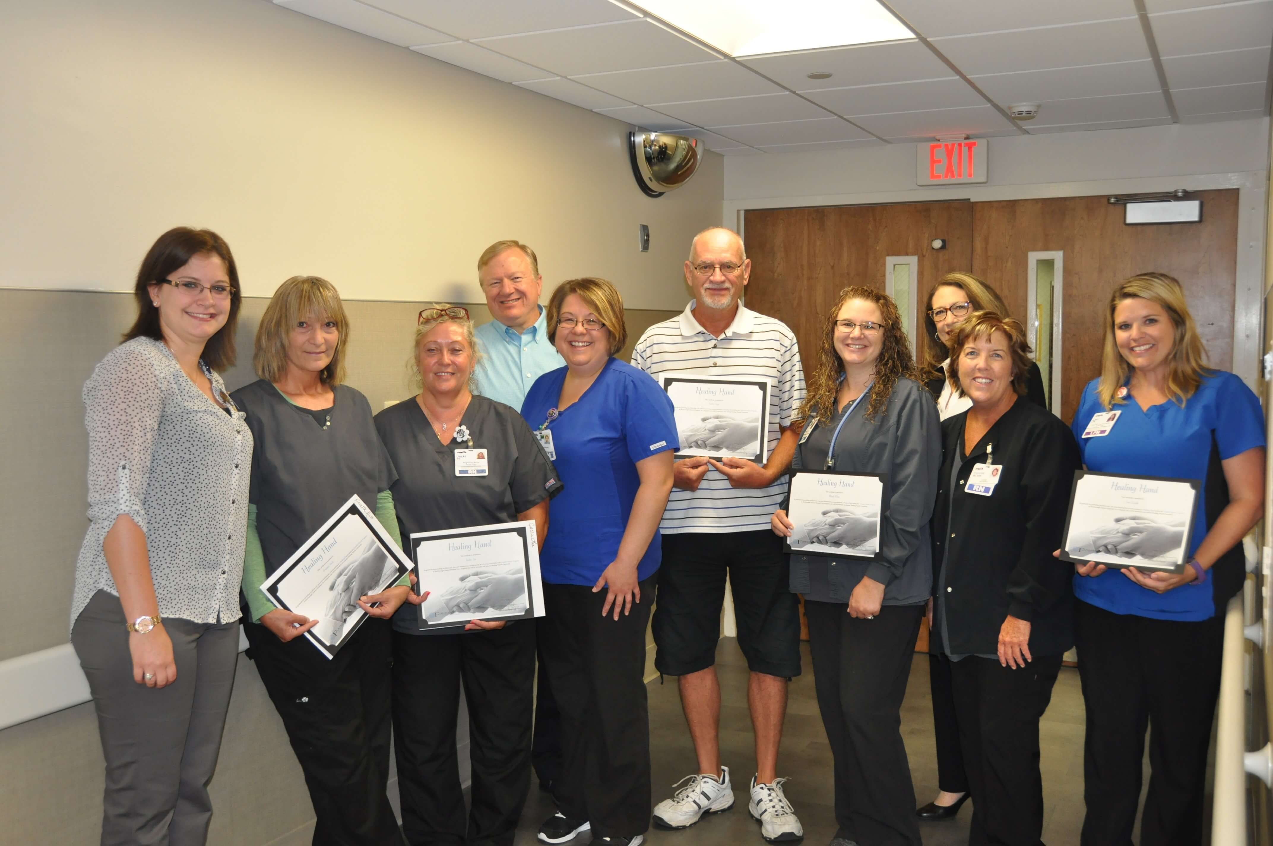 Acute care staff with award