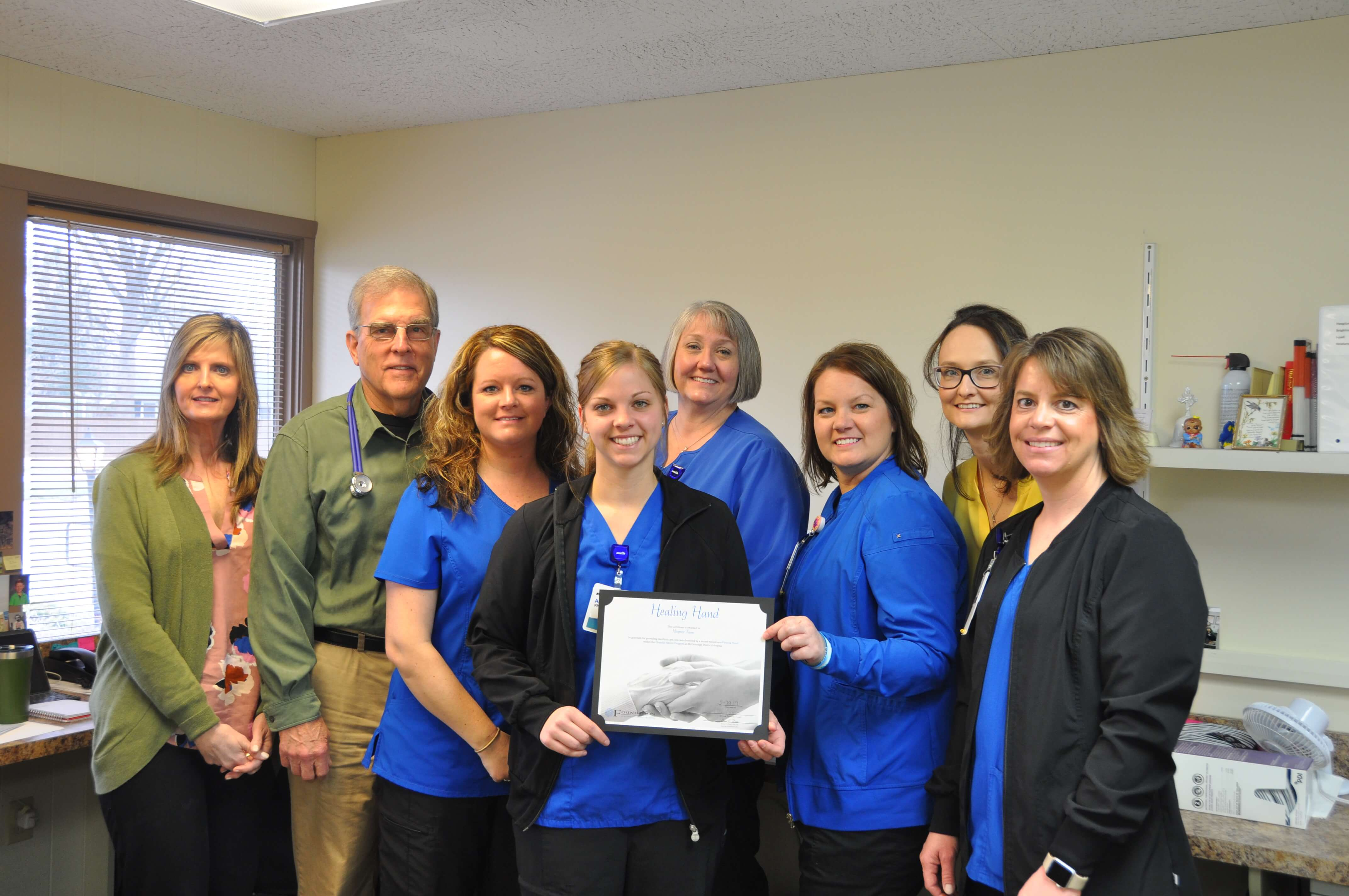 hospice staff with award