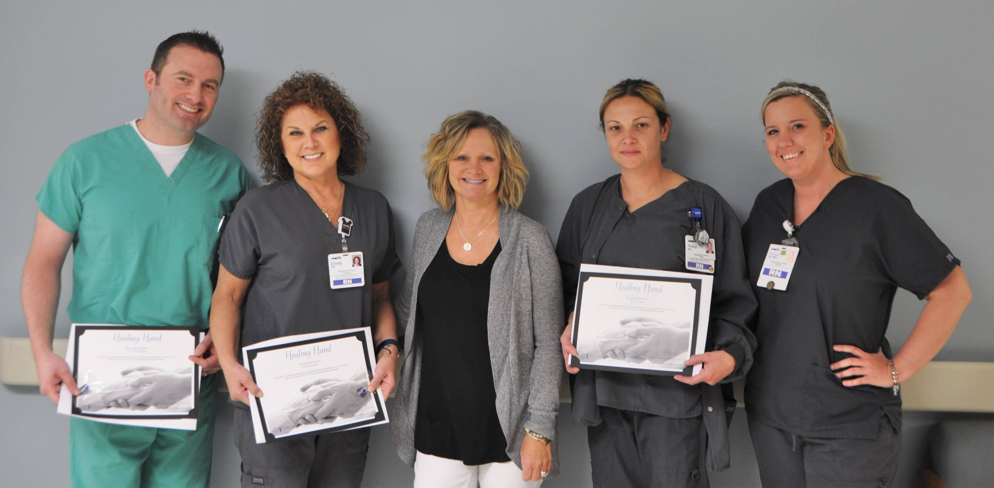 surgical team with award